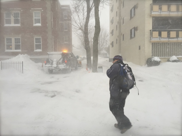 A man walks along Massachusetts Avenue during a snowy, windy day. February 2, 2015.