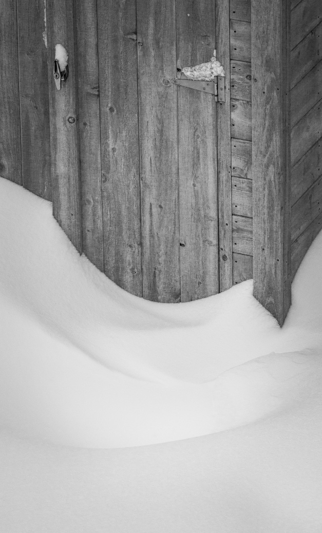 Drifts of snow cut their way to the door of a shed. February 09, 2015.