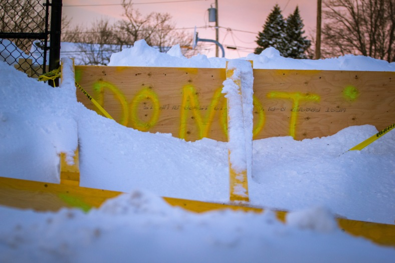 Plywood prevents—and warns—people not to use this Pheasant Avenue entrance to the Stratton School blacktop. February 10, 2015.