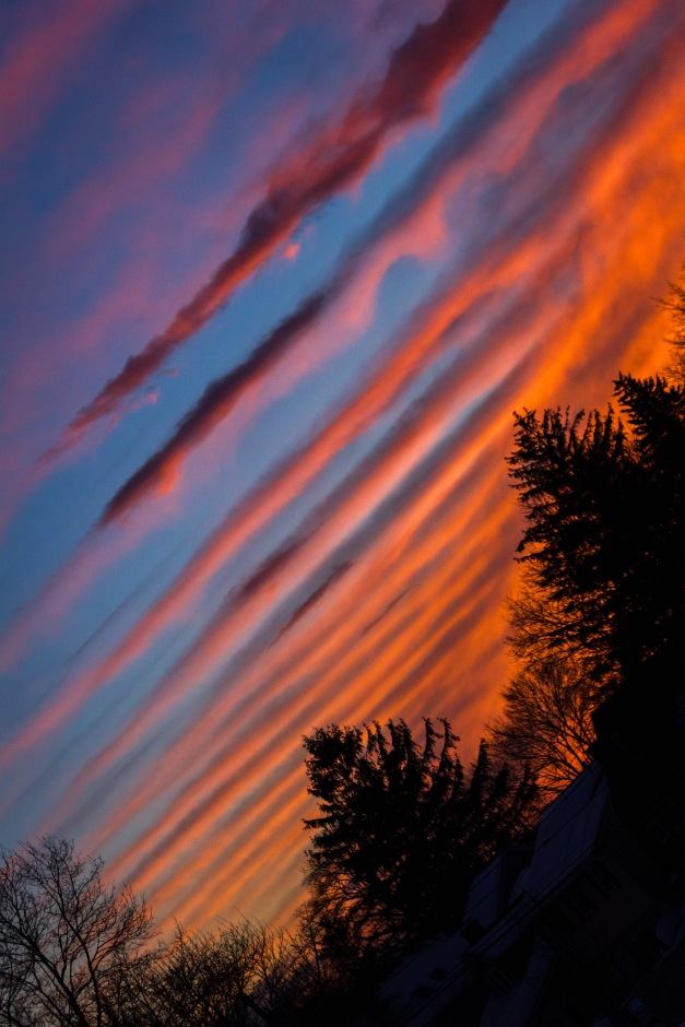 Clouds striped the sky for a colorful sunset over Arlington. February 10, 2015.