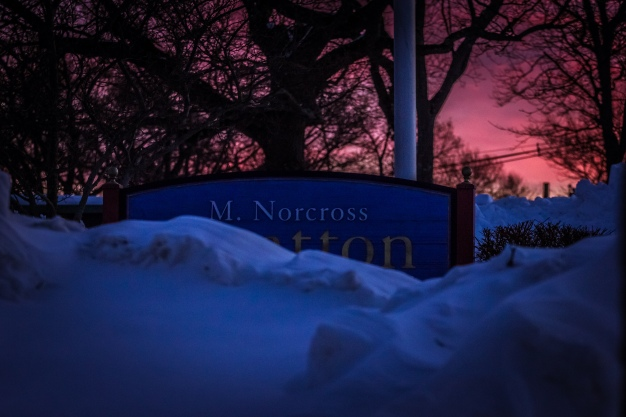 Snow piled high around the sign at the Stratton School. February 10, 2015.