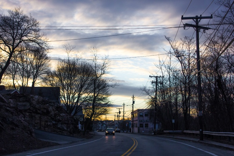 The sun starts to light up the sky over Summer Street in the early morning. March 21, 2014.