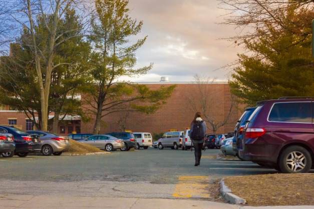A student walks up Carey Drive on her way to start her day at Arlington High School. March 21, 2014.