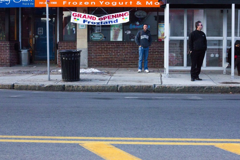 People wait at a bus stop in front of Frozland near Arlington High School. March 21, 2014.