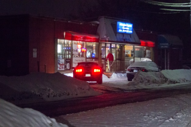 A man makes a late night run to the package store on Summer Street. March 01, 2015.
