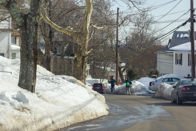 Kids run down Hemlock street with their basketballs on a relatively warm winter day. March 07, 2015. SC