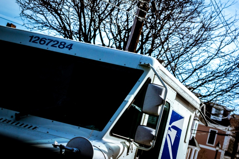 A USPS mail truck driving down Mill Street. March 07, 2015. SC