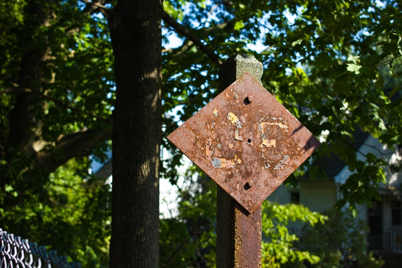 An old rusted railroad sign along the Minuteman Bikeway. September 11, 2013.