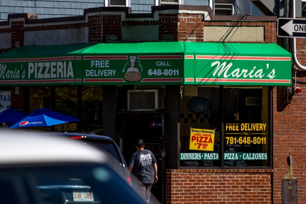 An employee walks into Maria's Pizzeria on Massachusetts in East Arlington. June 20, 2014.