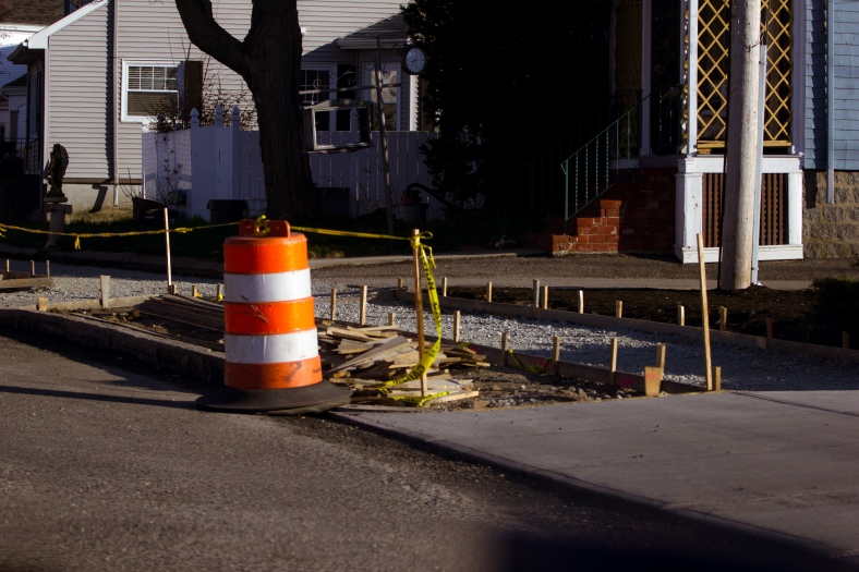 Stakes mark off a section of what is to be a new sidewalk along Massachusetts Avenue. May 02, 2015.