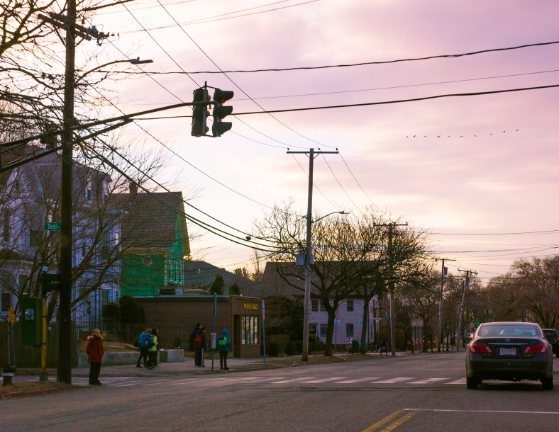 A group of children wait for the 77 bus to take them down Massachusetts Avenue to school. March 21, 2014.