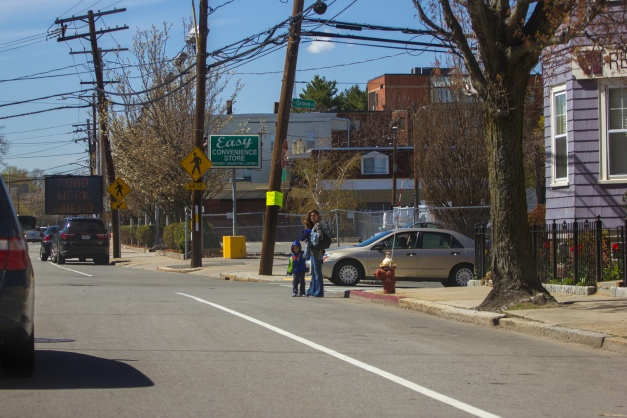 A woman and child looking both ways before crossing Massachusetts Avenue. May 02, 2015. SC