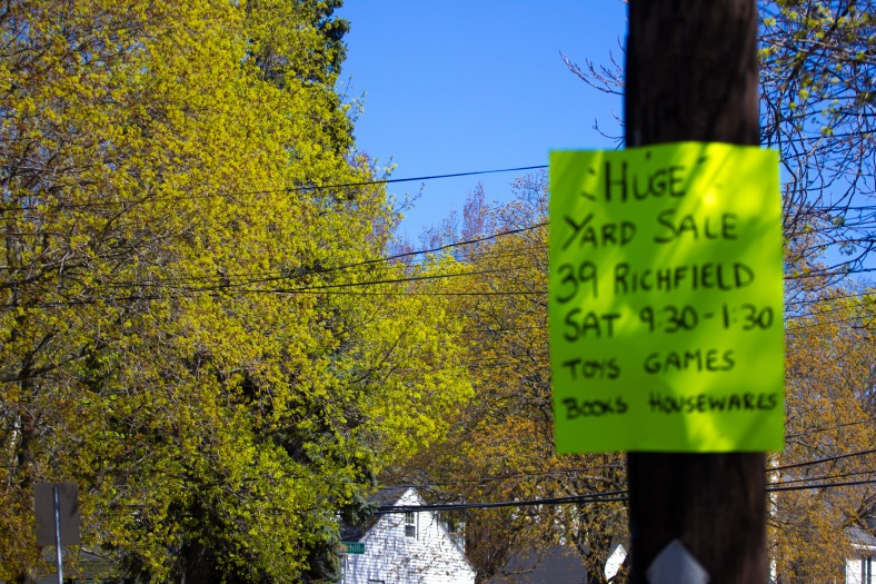 A sign (that nearly matches the budding leaves) advertising a yard sale on Summer Street. May 02, 2015.