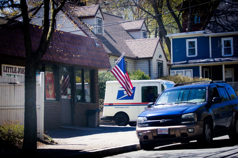 A mail truck pulls out of Summer Street Place next to Little Joe's convenience store. May 02, 2015. SC