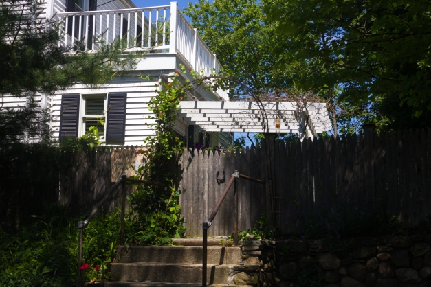 The fence leading into the yard of a home along Pond Lane. June 07, 2015.
