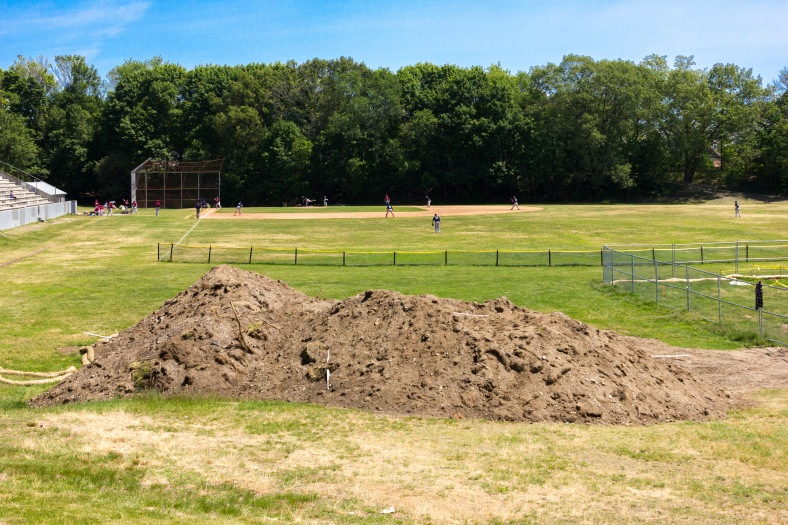A baseball game played at a Spy Pond field that looks a bit dirtier due to the installation of new tennis courts. June 07, 2015.