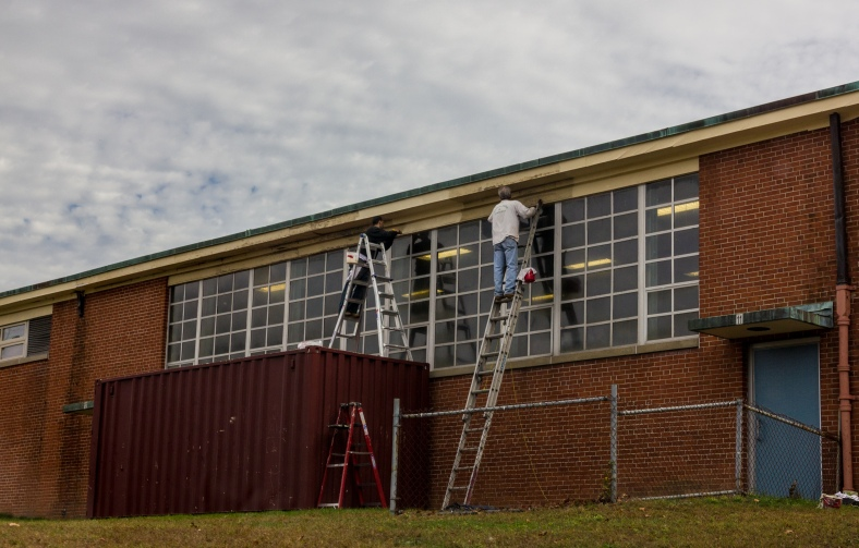 A new coat of paint is added to the eaves of Stratton School. October 22, 2013.