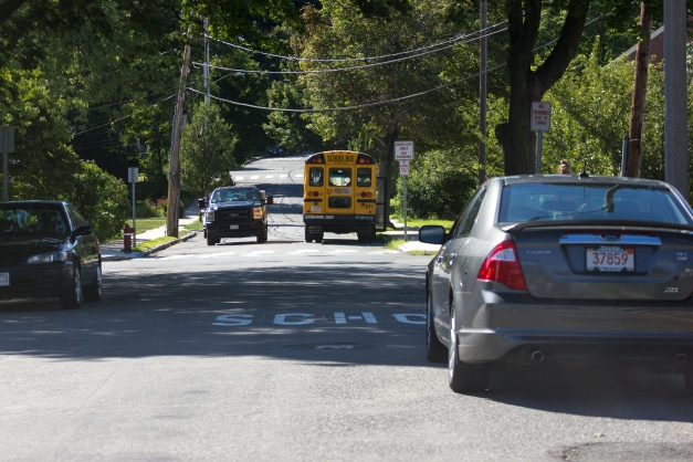 A bus sits outside the Bishop Elementary School on Columbia Road after dropping off kids from a day at summer camp. August 05, 2015.