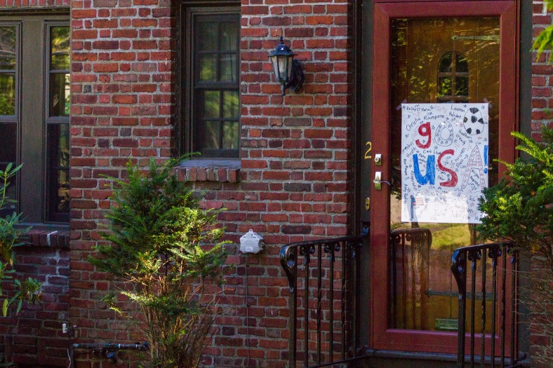 Fans along West Upland Road display a homemade sign supporting the U.S. Women's National Soccer Team after they won the 2015 World Cup. August 05, 2015.