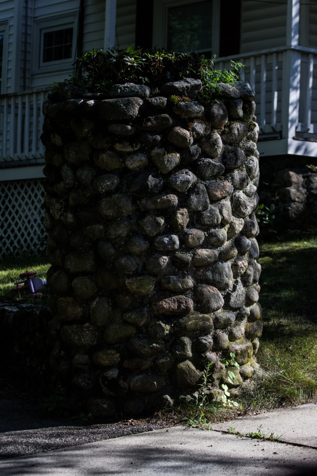 A stone feature in the front yard of a Pine Ridge Road home. August 05, 2015.