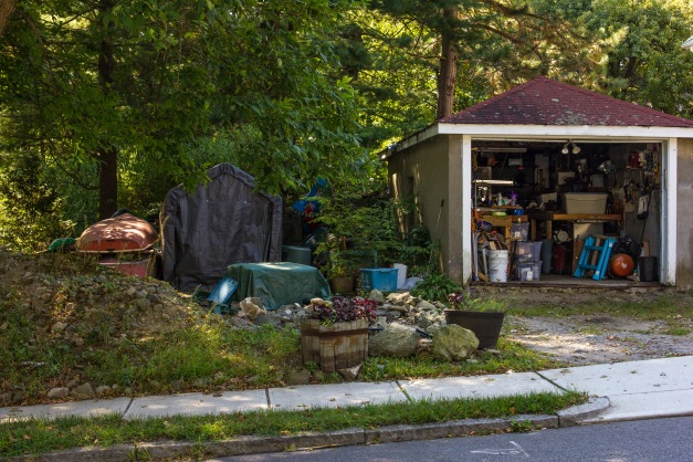 A garage and side yard of a Washington Street home. September 11, 2013.