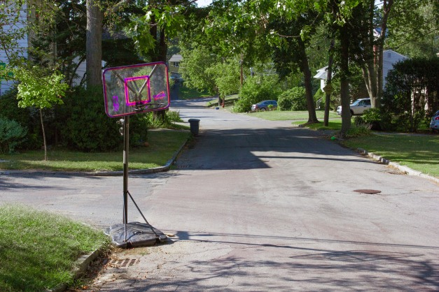 An adjustable height basketball goal on Woodside Lane. September 11, 2013.