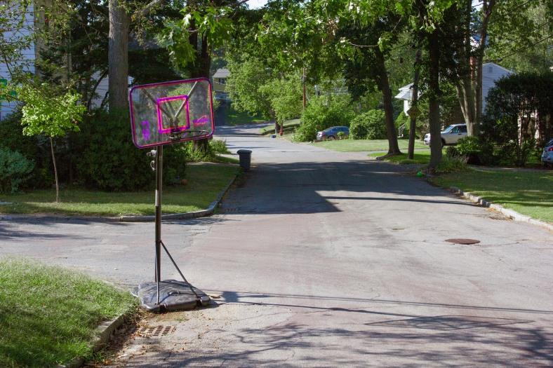An adjustable height basketball goal on Woodside Lane. September 11, 2013.