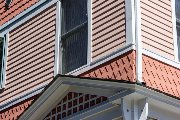 Different patterns of siding on a house along Lewis Avenue. August 29, 2015.
