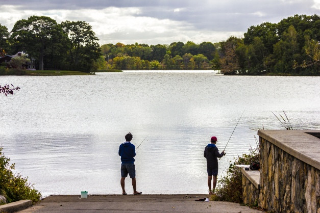 People fish at the end of the boat launch at Spy Pond. October 04, 2015.
