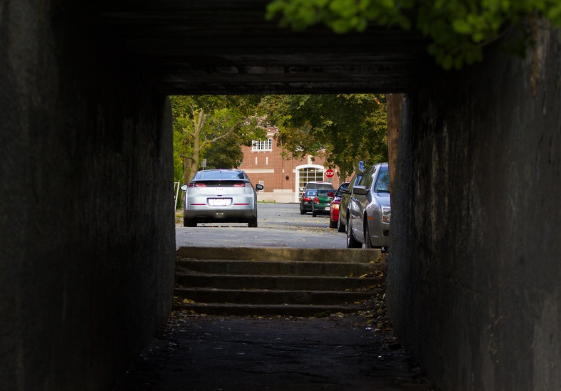 A short tunnel under what once was the Boston and Maine rail line that now carries the Minuteman Bikeway over a connection between Spy Pond field and Whittemore Street. October 04, 2015.