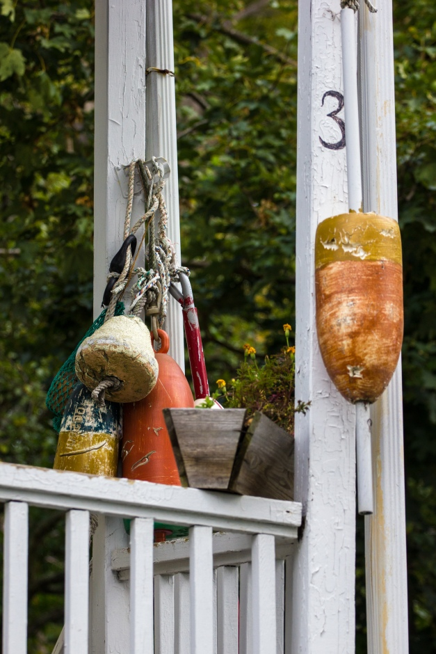 Buoys adorn a pond Terrace home. October 04, 2015.