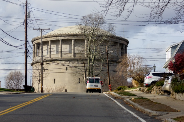 An electric company truck parked on Eastern Avenue in front of the imposing Park Avenue water tower. November 26, 2015.