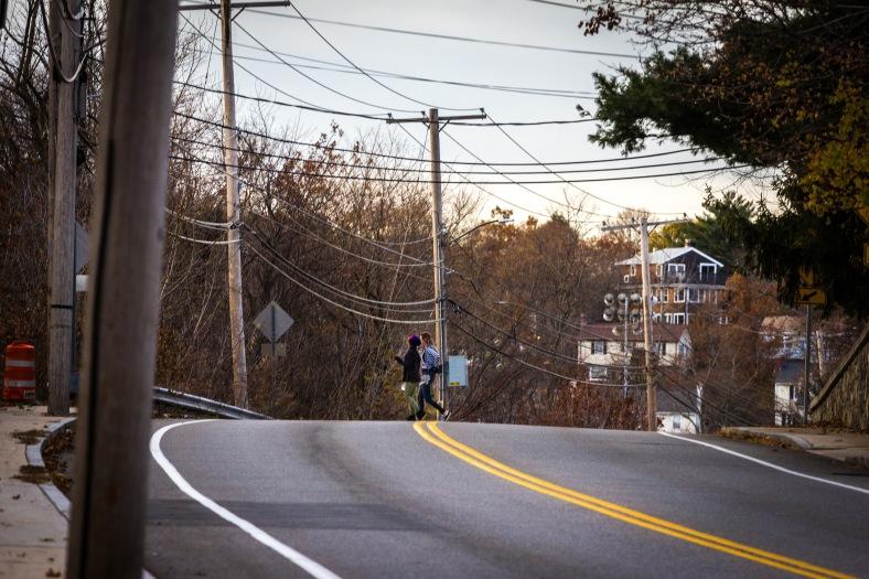 Two girls cross Summer Street. November 15, 2013.