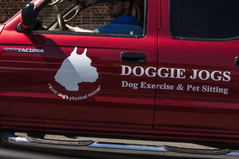 The truck of a canine-centric business driving up Highland Avenue. April 26, 2013.