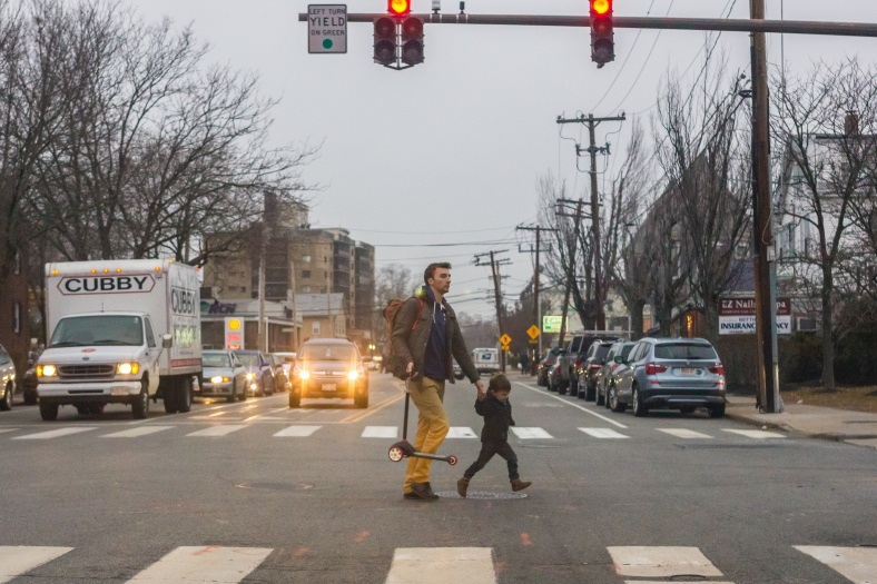 A child and his father cross Massachusetts Avenue near the Stop and Shop supermarket. December 14, 2015.