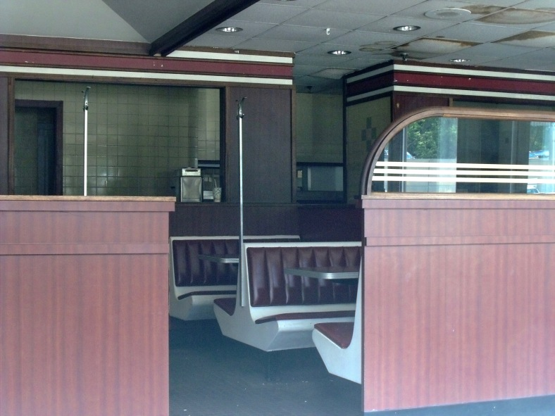 The seating area at the defunct Brigham's Restaurant behind the  Mill Street company's headquarters. August 9, 2010.