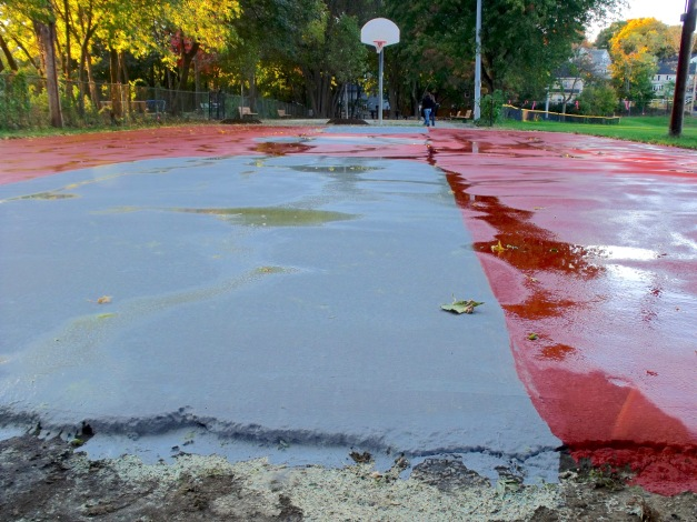 Puddles on the basketball court at Summer Street field. October 21, 2010.