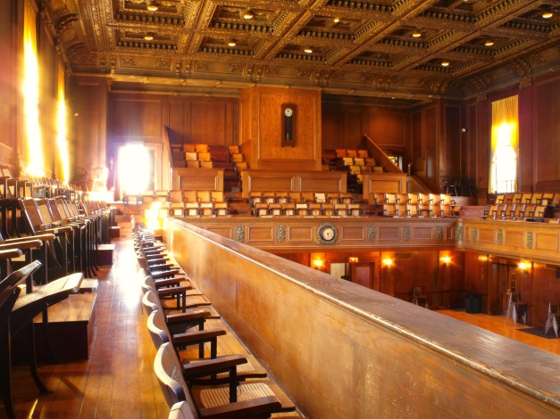 Sun streams into the upper seating gallery of Arlington's Town Hall February 14, 2011.
