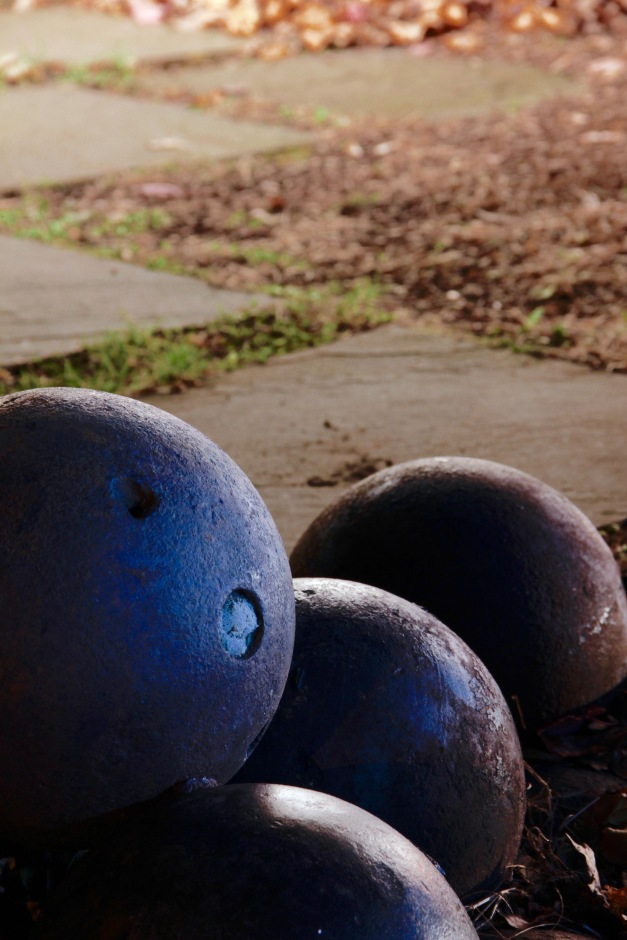 Cannon balls stacked as part of a monument in Arlington Center. November 26, 2011.
